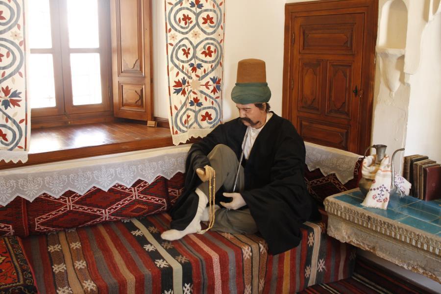 diorama patung lilin sufi